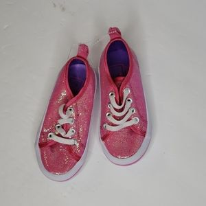 Disneys Doc McStuffin pink glitter sneakers.